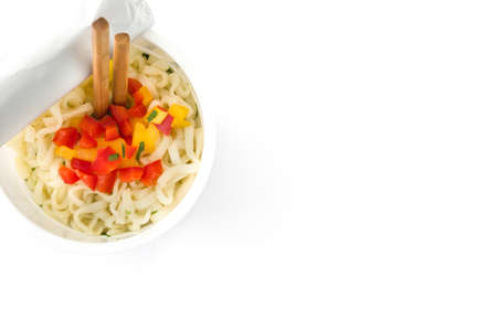 Take away noodles with vegetables isolated on white background.Top view. Copyspace Banco de Imagens