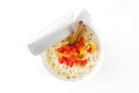 Take away noodles with vegetables isolated on white background.Top view. Banco de Imagens