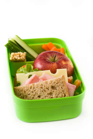 Healthy school lunch: Sandwich, vegetables and fruit isolated on white background