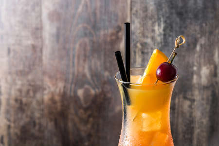 beach cocktail in glass on wooden table. Copyspace Stock Photo