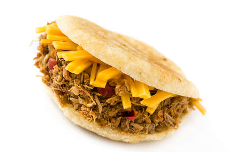 Arepa with shredded beef and cheese isolated on white background. Venezuelan typical food. 版權商用圖片