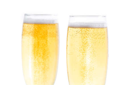 Champagne glasses isolated on white background. Close up