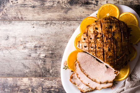 Traditional homemade honey Glazed Ham for holidays. Top view. Copyspace Stock Photo