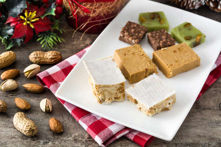 Christmas nougat on wooden table.