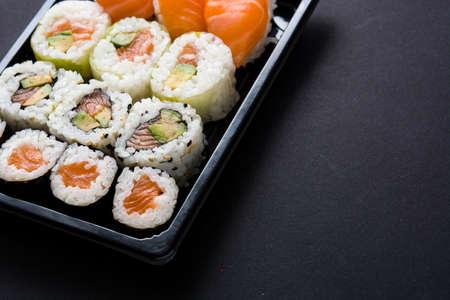Japanese food: maki and nigiri sushi set on black background. Copyspace Banco de Imagens