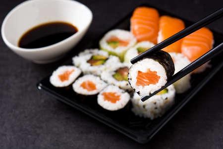 sushi and chopstick on sushi pack background. Close up