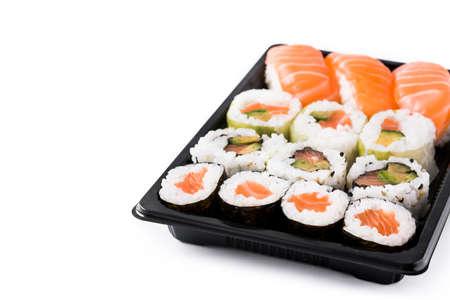 sushi assortment on black tray isolated on white background. Copyspace Banco de Imagens