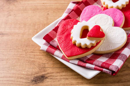 Heart-shaped cookies for Valentines Day on wooden background. Copyspace Stock Photo
