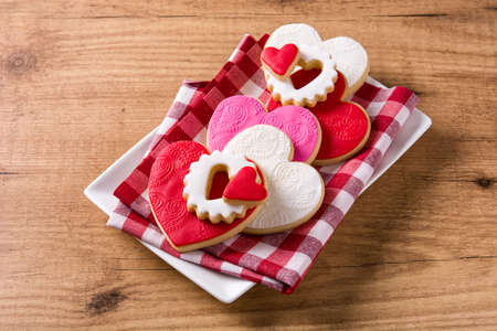 Heart-shaped cookies for Valentines Day on wooden background.