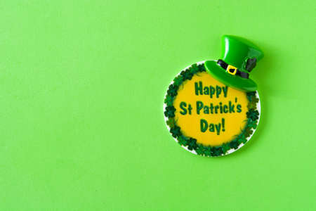 St Patrick's day symbols on green background. Copyspace