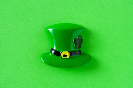 St Patricks Day hat on green background. Top view