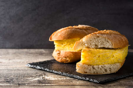 Spanish tortilla sandwich. Spanish potato omelette sandwich on slate background. Copyspace