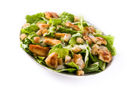 Caesar salad with lettuce, chicken and croutons isolated on white background