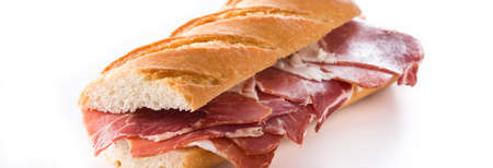 Spanish ham sandwich isolated on white background. Panoramic view