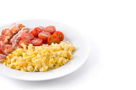 Breakfast with scrambled eggs, bacon and tomatoes isolated on white background. Copyspace