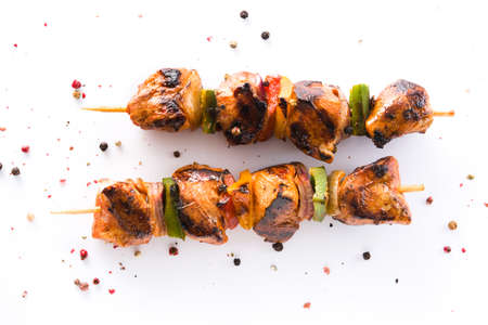 Chicken shish kebab with vegetables isolated on white background. Top view