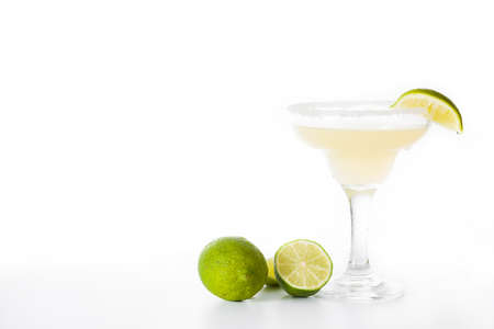 Margarita cocktail with lime in glass isolated on white background. Copyspace