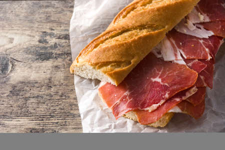 Spanish ham sandwich on wooden table