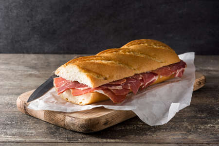 Spanish sandwich on wooden table.