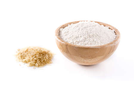 White rice flour in a bowl isolated on white background