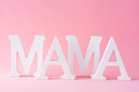 Mama word on pink background. Mother's Day concept. Stock Photo
