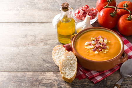 Typical Spanish salmorejo cream with ham and egg on wooden table. Copyspace Standard-Bild - 119533120