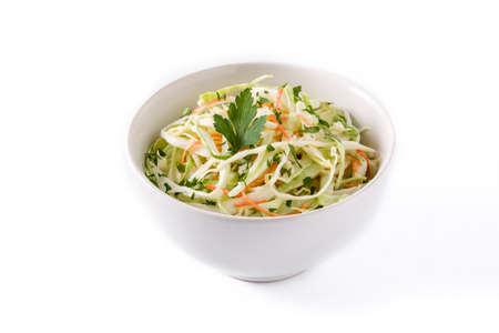 Coleslaw salad in white bowl isolated on white background