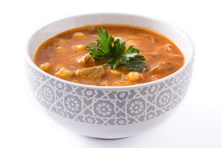 Harira soup in bowl isolated on white background. Typical Moroccan food. Ramadan concept.