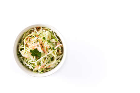 Coleslaw salad in white bowl isolated on white background. Top view. Copyspace Banco de Imagens