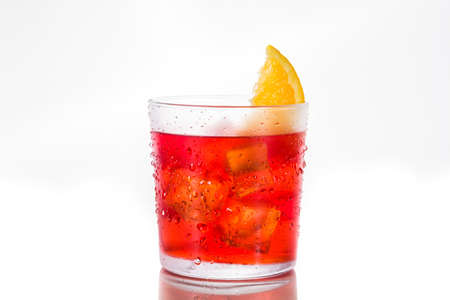 Negroni cocktail with piece of orange in glass isolated on white background 写真素材