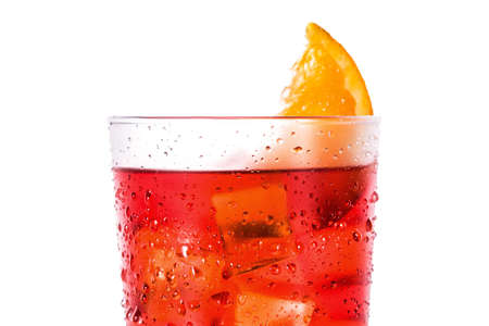 Negroni cocktail with piece of orange in glass isolated on white background. Close up Imagens - 123035217