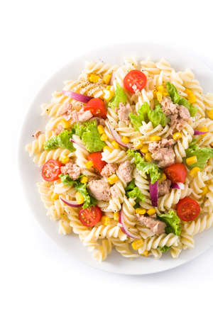 Pasta salad with vegetables isolated on white background. Top view.