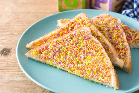 Traditional Australian fairy bread on wooden table