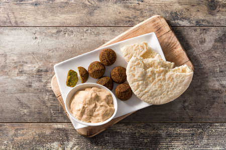 Falafel on a plate on wooden table