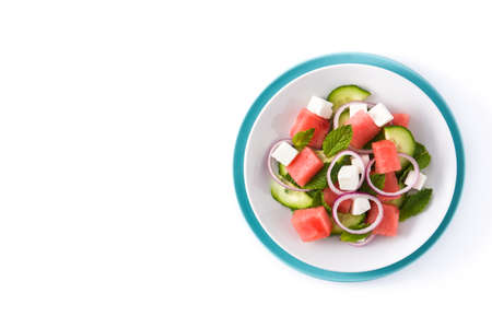 Watermelon salad with feta cheese and vegetables isolated on white background