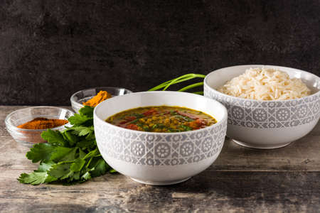 Indian lentil soup dal (dhal) in a bowl on wooden table.