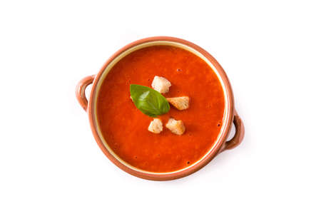 Tomato soup in brown bowl isolated on white background. Top view