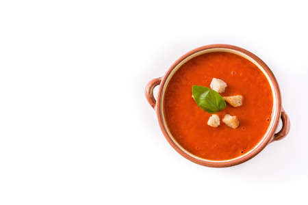 Tomato soup in brown bowl isolated on white background. Top view. Copyspace Imagens
