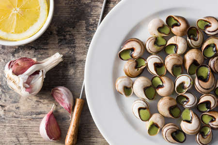 Bourgogne Escargots on wooden table. Top view