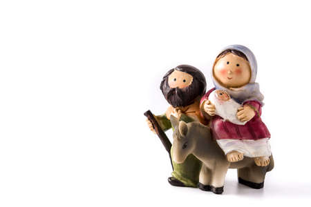 Figures representing Nativity scene isolated on white background.Jesus, Maria and Jose. Copy space Imagens
