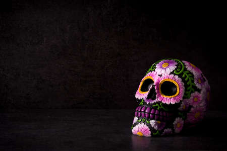 Typical Mexican skull painted on black background.Copyspace. Dia de los muertos. Banco de Imagens