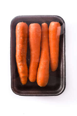 Carrots packaged in plastic isolated on white background. Top view Stock Photo