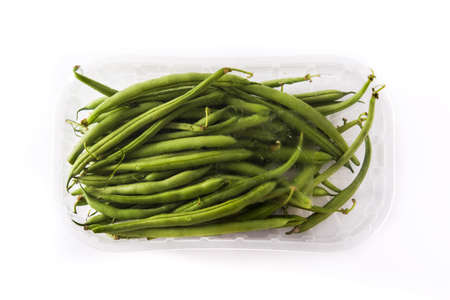 Green beans packaged in plastic isolated on white background