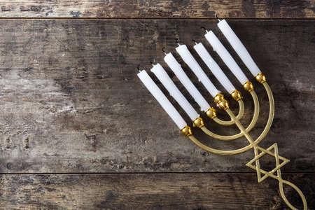Jewish Hanukkah menorah on wooden table.Top view. Copy space