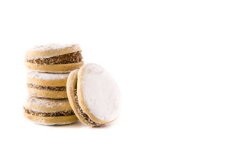Traditional Argentinian alfajores with dulce de leche and sugar isolated. Copy space