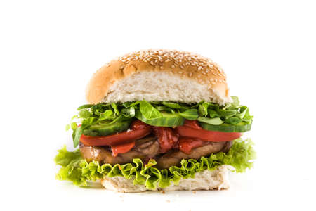 Vegan burger with seitan and vegetables isolated on white background. Fake meat.