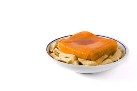 Typical Portuguese francesinha sandwich with french fries isolated on white background. Copy space Foto de archivo - 138099835