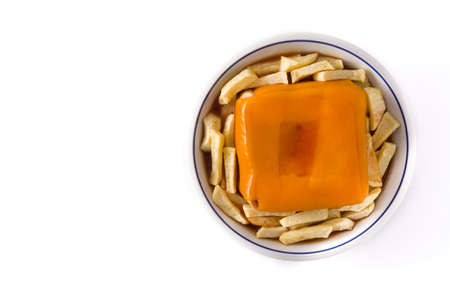 Typical Portuguese francesinha sandwich with french fries isolated on white background. Top view Copy space Foto de archivo - 138099843