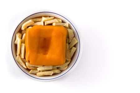 Typical Portuguese francesinha sandwich with french fries isolated on white background. Top view Copy space Foto de archivo - 138099858