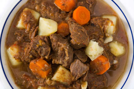 Irish beef stew with carrots and potatoes isolated on white background close up Stock Photo